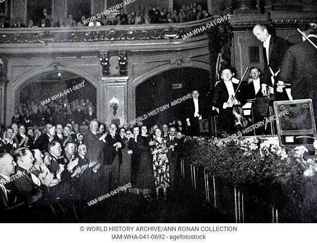 Adolf Hitler 1889-1945. German politician greets Gustav Heinrich Ernst Martin Wilhelm Furtwängler (January 25, 1886 – November 30