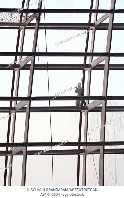 Men at work cleaning the glass roof of the new opera house near Tian Nen Men square , opening 2008 (Architect Paul Andreu from France )