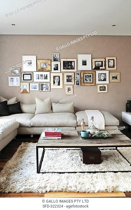 Living room with a corner sofa and photos on the wall