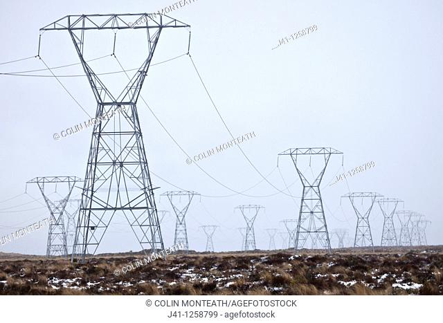 Power pylons on Rangipo desert during rain storm, Tongariro National Park