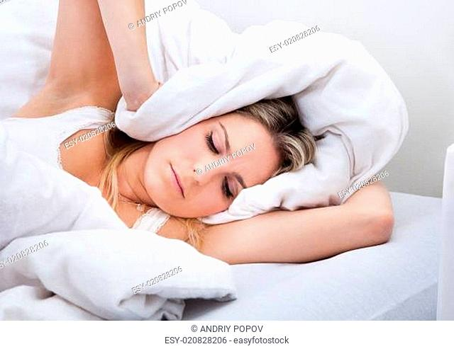 Woman with a bedsheet over her head