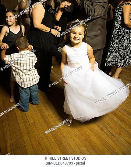 Hispanic girl dancing at wedding