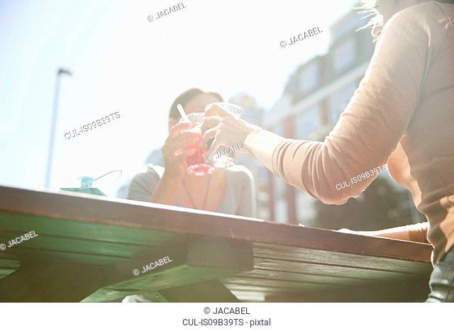 Friends enjoying drinks in pub, London