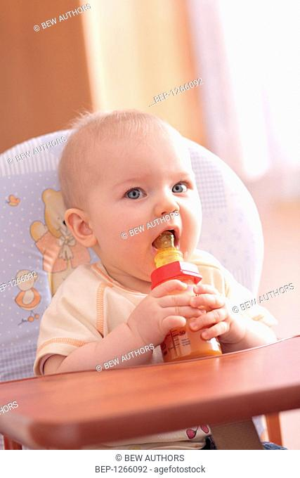 Baby drinking carrot juice