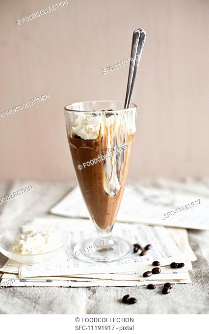 Coffee mousse with cream, partly eaten