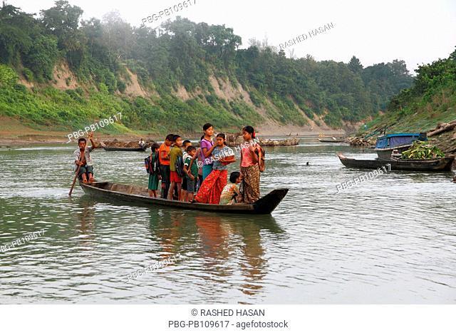 Ethnic children going to school by boat through the Sangu River Thanchi, Bandarban, Bangladesh November 2010