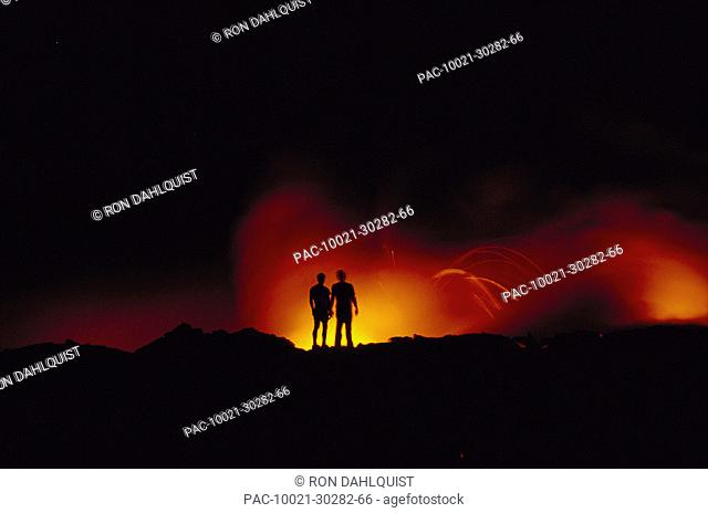 Hawaii Volcano National Park two people silhouette @ night glow D1547 lava explosions