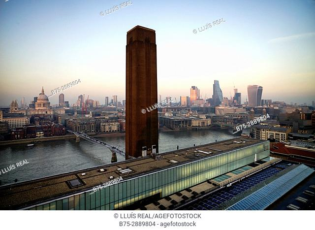 View of Tate modern with office and residential buildings in the evening. London, England