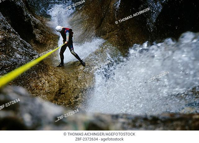 man by the canyoning was rope down himself