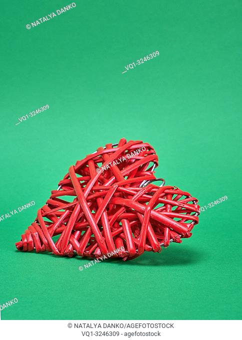 decorative red wicker heart on a green background