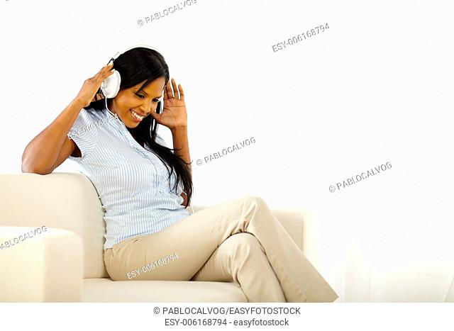Lovely young lady listening to music while having fun at home