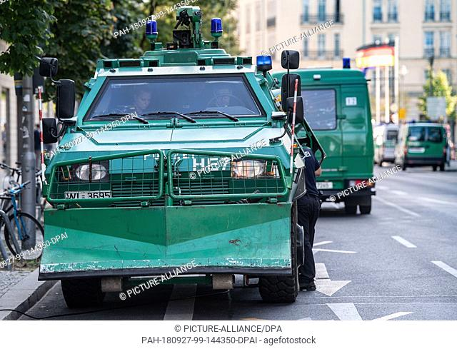 27 September 2018, Berlin: A special police car stands in a side street after the arrival of the Turkish president. Turkish President Erdogan is on a three-day...