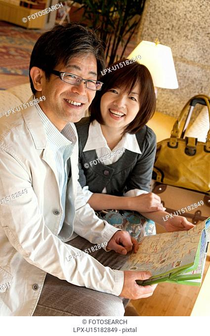 Middle-aged Couple with Map