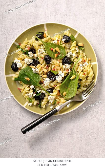 Fusilli with spinach, olives, feta and pine nuts