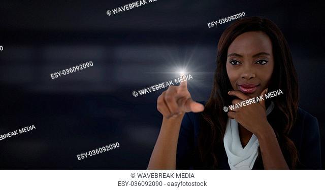 Businesswoman touching air glow