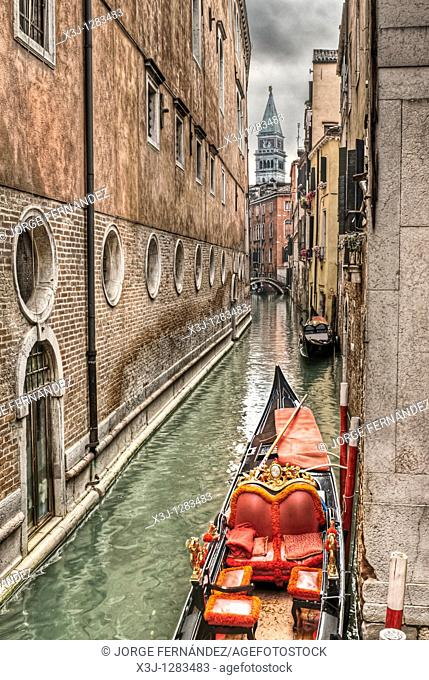 Canals of Venice, gondolas and the Campanile in view, Venice, Italy, Europe