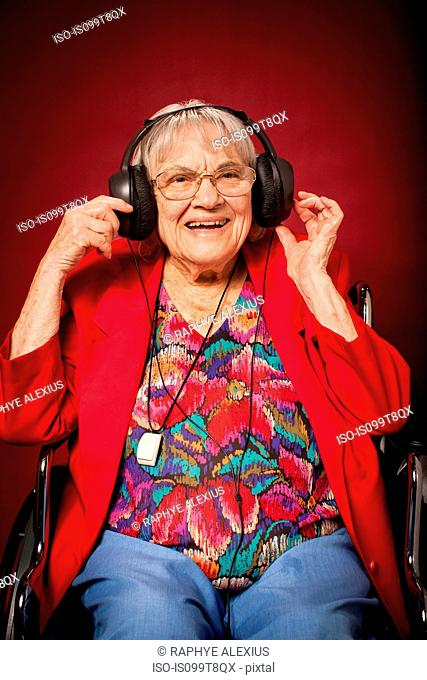 Senior woman listening to music on headphones