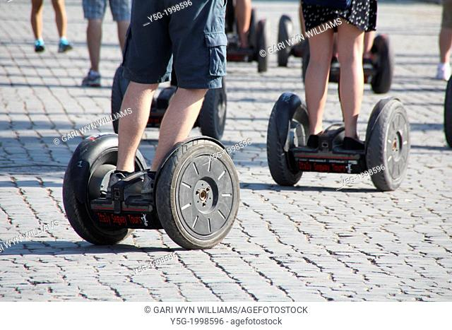 people riding segway transporters in rome italy