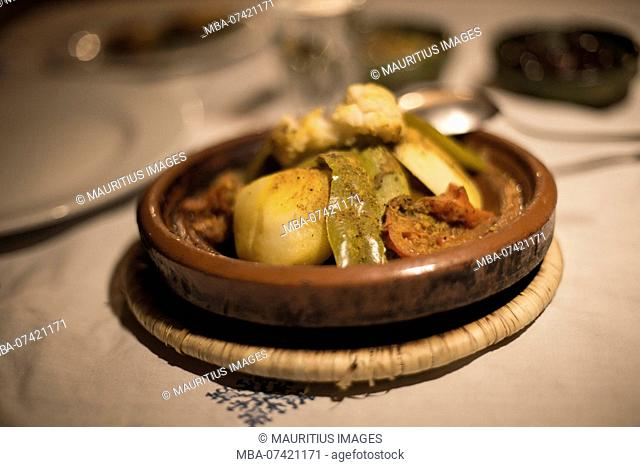 Morocco, Quarzazate, travel route along road N9, stop for food, typical dish