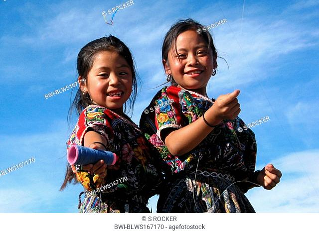 Two Mayan children in traditional costume let fly a kite in Comalapa, Guatemala, Quiché, Comalapa