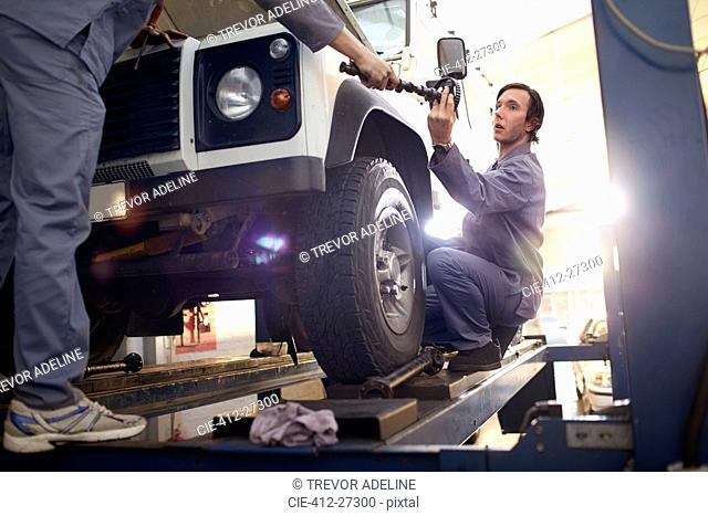 mechanics working in auto repair shop