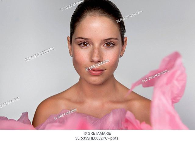 Woman wrapped in tissue paper