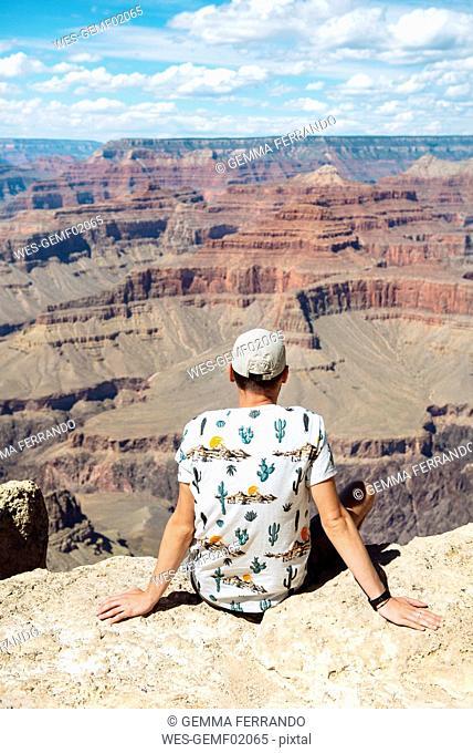 USA, Arizona, Young man enjoying the landscape of Grand Canyon National Park