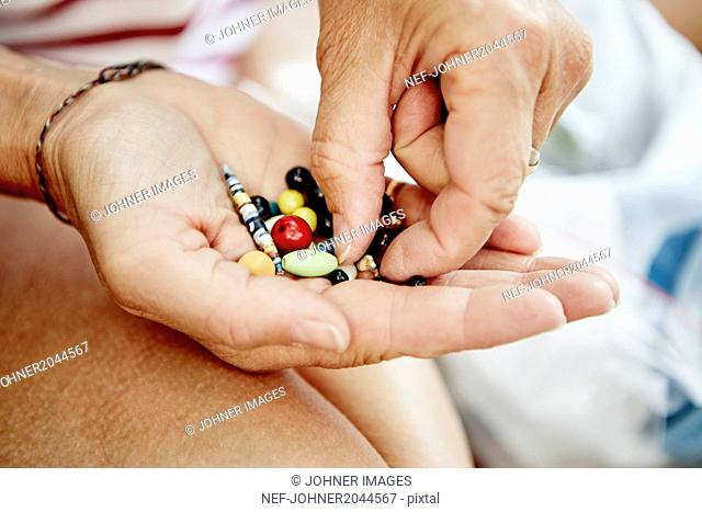 Beads on womans hand