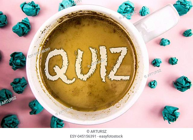Handwriting text Quiz. Concept meaning Short Tests Evaluation Examination to quantify your knowledge written Coffee in White Cup within Crumpled Paper Balls...