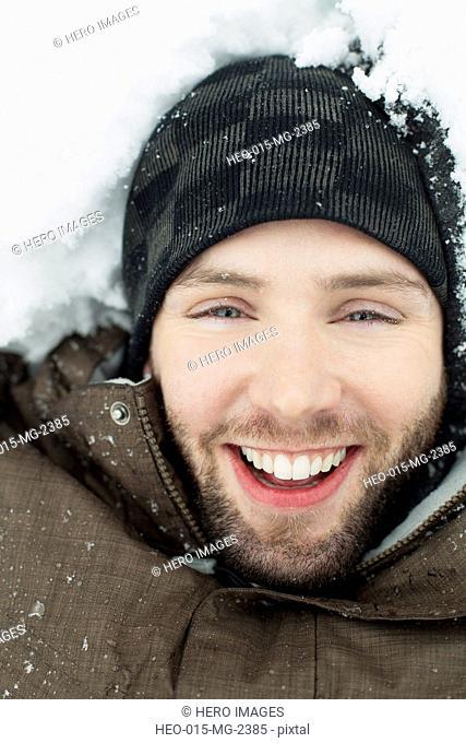 man lying in snow