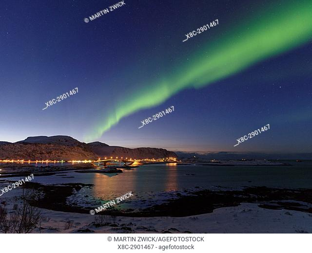 Northern Lights over the bridges of Fredvang (Fredvangbruene) connecting the islands Moskenesoya and Flakstadoya. The Lofoten Islands in northern Norway during...