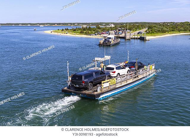 The Chappy Ferry transports cars, cyclists, and passengers across the harbor to Chappaquiddick Island in Edgartown, Massachussetts on Martha's Vineyard