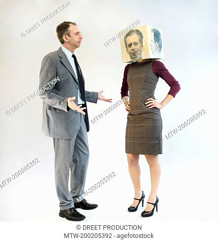 Businessman arguing with businesswoman wearing mask