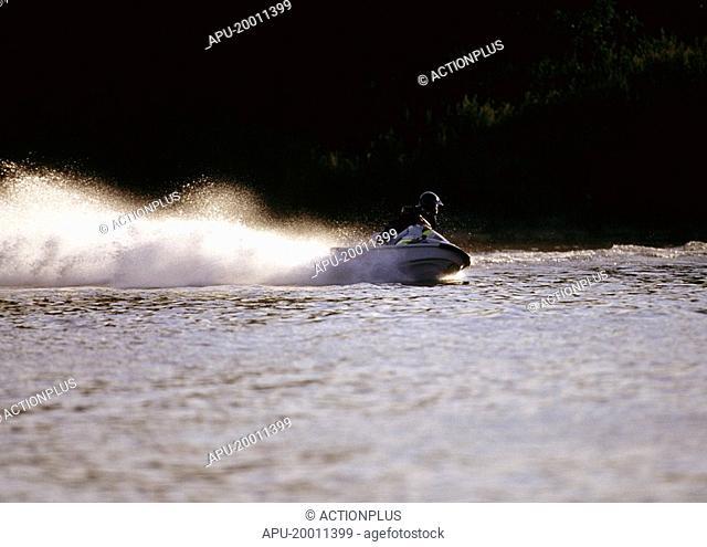 Jet ski rider takes a sharp turn causing large wake