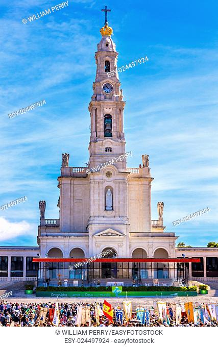 May 13th Celebration of Mary's Appearance Banners Pilgrims Basilica of Lady of Rosary Bell Tower Fatima Portugal. Church created on site where three Portuguese...