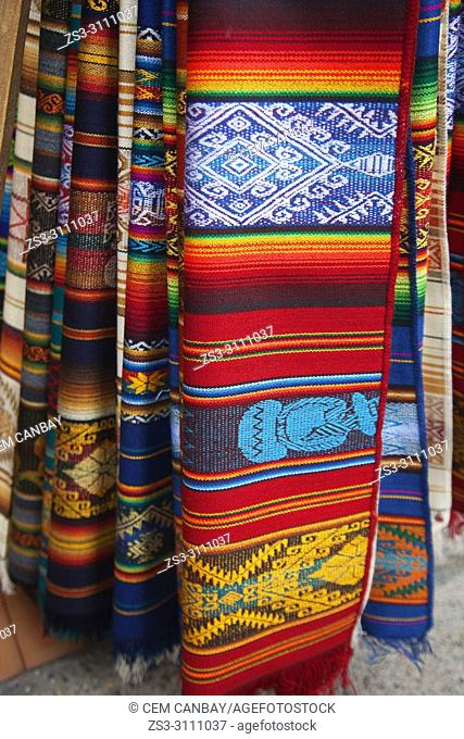 Close-up shot of the colorful traditional blankets and rugs in the shop at the Art and Craft market in the historic center, Bogota, Cundinamarca, Colombia