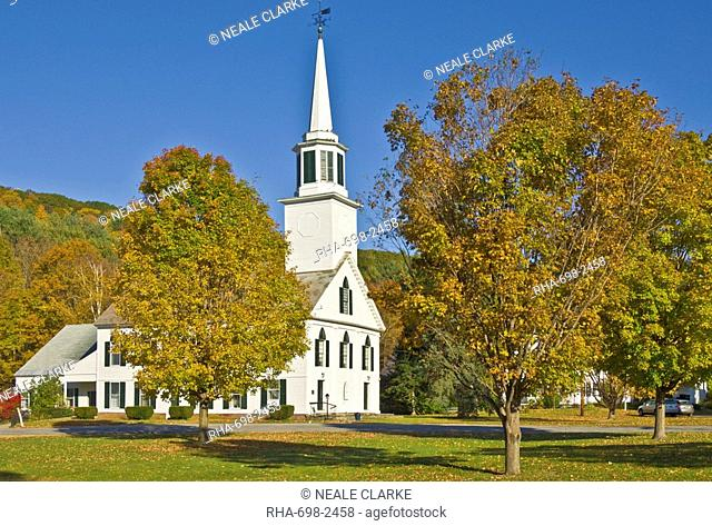 Autumn colours around traditional white timber clapperboard church, Townshend, Vermont, New England, United States of America, North America
