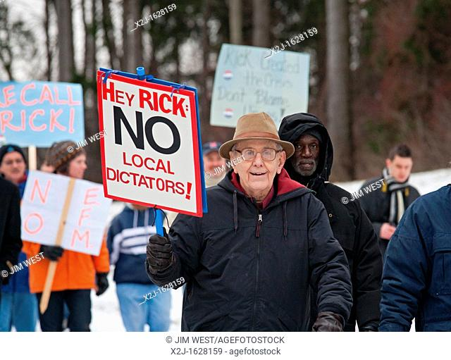 Superior Township, Michigan - About a thousand people marched to the home of Michigan Governor Rick Snyder to protest Michigan's emergency financial manager law...