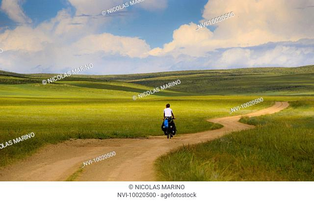 Cycling through the grasslands of the Mongolian steppe, Mongolia