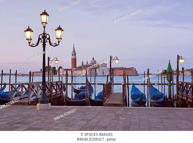 Gondolas moored along river