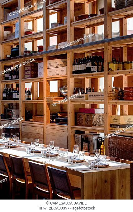 Spain, Catalonia, Barcelona, Santa Caterina market, Tables and shelves at Cuines Santa Caterina restaurant