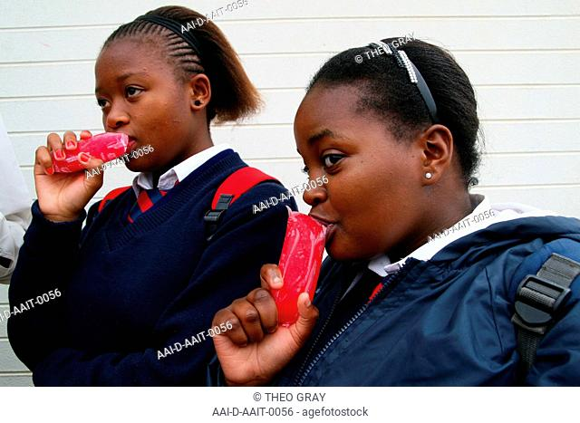 School girls outside eating ice lollies, St Mark's School, Mbabane, Hhohho, Kingdom of Swaziland