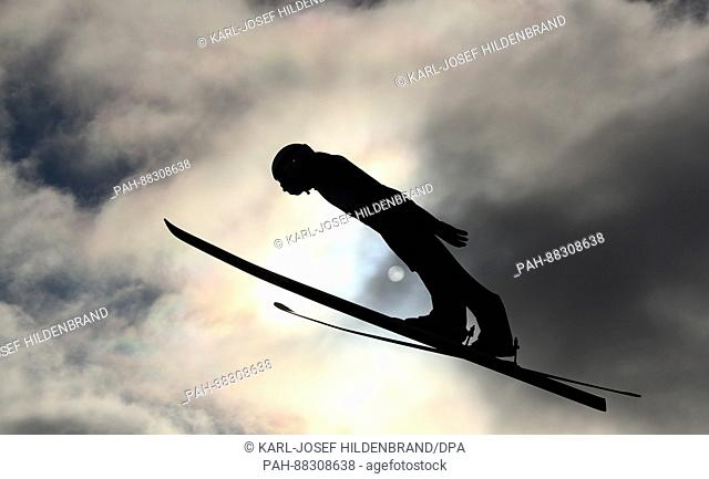 A ski jumper trains before the setting sun ahead of the Nordic World Ski Championships in Lahti, Finland, 21 February 2017