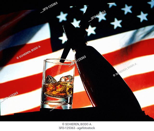 Spraying Soda Water into Glass of Whiskey