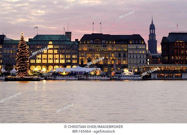 Christmas tree on lake Alster and Jungfernstieg in Hamburg, Germany