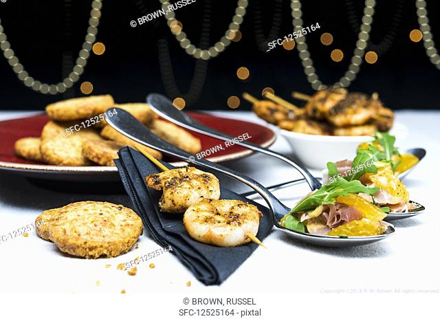 Prawn skewers with clementine salad, prosciutto and parmesan shortbreads