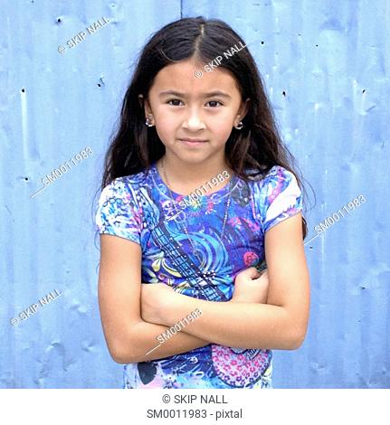 Young girl looking at camera with a serious face