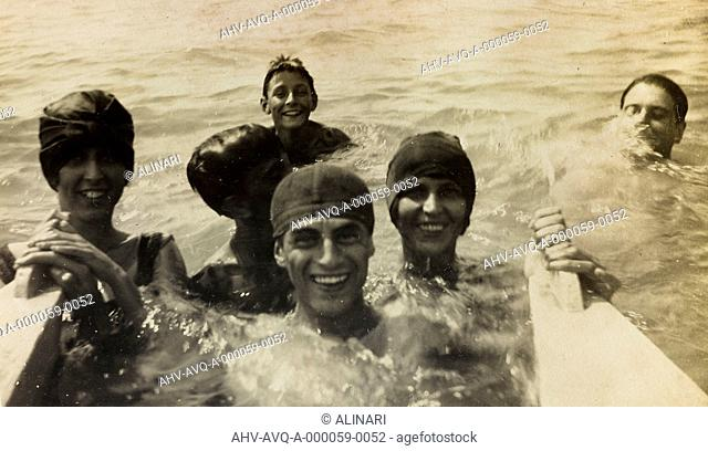 Portrait of a group of smiling young people taking a bath in the sea, Versilia, shot 07-08/1923