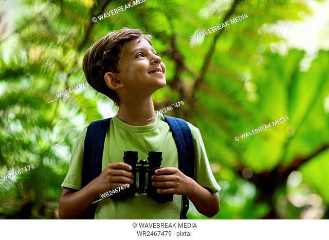 Happy boy holding binoculars