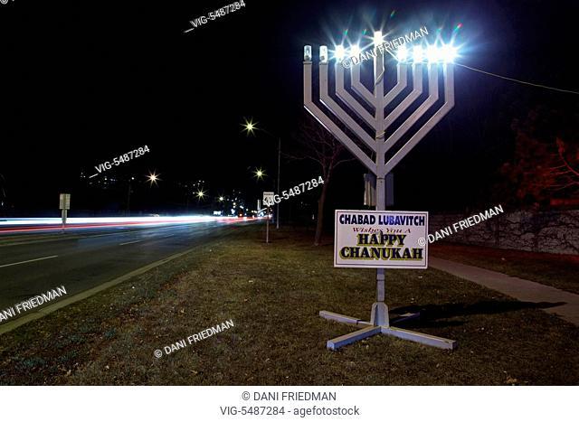 A large menorah illuminated during the Jewish holiday of Hanukkah (Chanukah) in Toronto, Ontario, Canada. - TORONTO, ONTARIO, CANADA, 11/12/2015